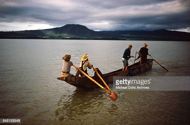 A group of fishermen row their boat on the lake in Patzcuaro Michoacan Mexico