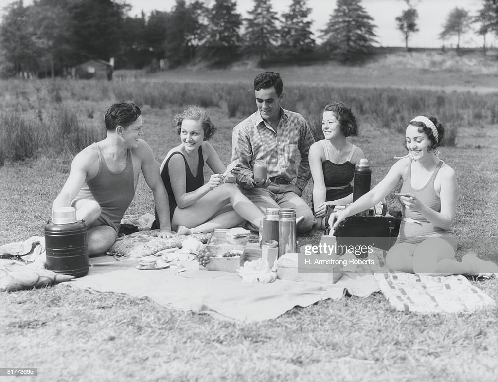Group of five people having summer picnic on beach. : Stock Photo