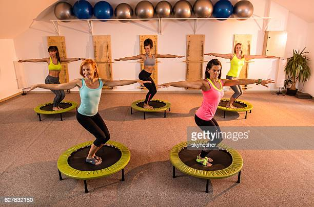 Group of five women exercising on mini trampolines.