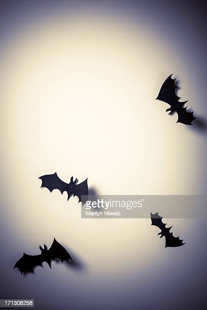 group of flying paper bats