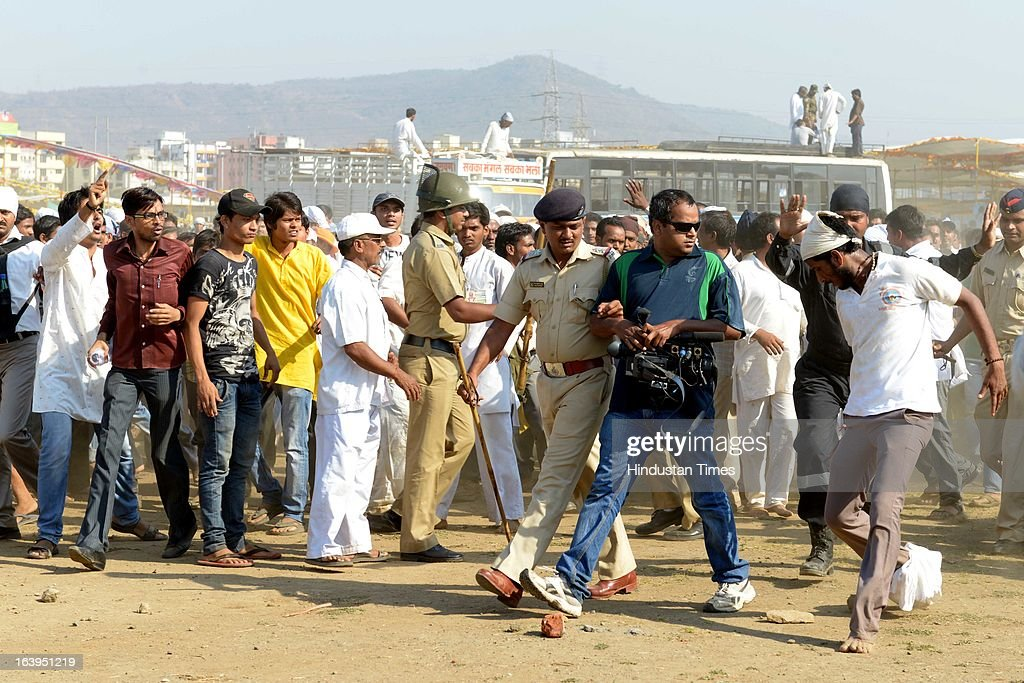 A group of followers of Asaram Bapu assaulted media persons and damaged their equipment at Patni grounds, Airoli on March 18, 2013 in Mumbai, India. They were agitated as the media raised the issue of wastage of water at a pre-Holi function organised by him in drought-hit Maharashtra.