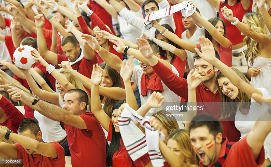 Group of football fans cheering. : Stock Photo