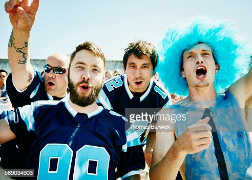 Group of football fans yelling in stadium