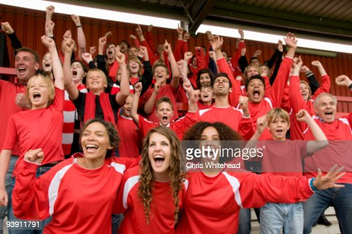 Group of football supporters celebrating