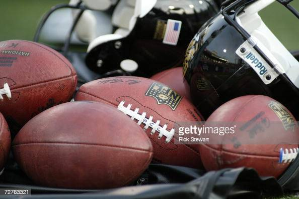A group of footballs are shown with Jacksonville Jaguars helmets before the game against the Buffalo Bills on November 26 2006 at Ralph Wilson...