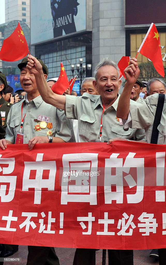 A group of former Chinese soldiers in the Korean War carry Chinese national flags and shout slogans during a protest in Chongqing against Japan's 'nationalizing' of the Diaoyu islands, also known as the archipelago Senkaku islands in Japanese. Thousands of anti-Japan protesters rallied across China over a territorial row on September 18, a key historical anniversary, as Japanese firms including car giant Toyota shut or scaled back production. CHINA