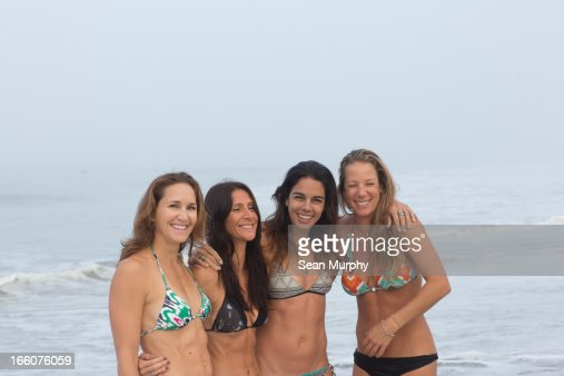 group of four girlfriends on beach