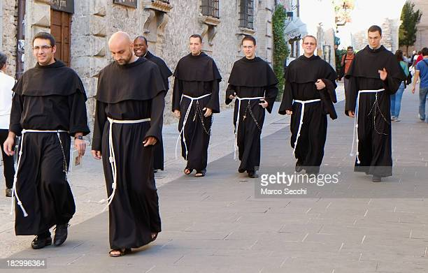 A group of franciscans friars walk in Assisi ahead of the visit of Pope Francis on October 3 2013 in Assisi Italy Pope Francis is due to venerate the...