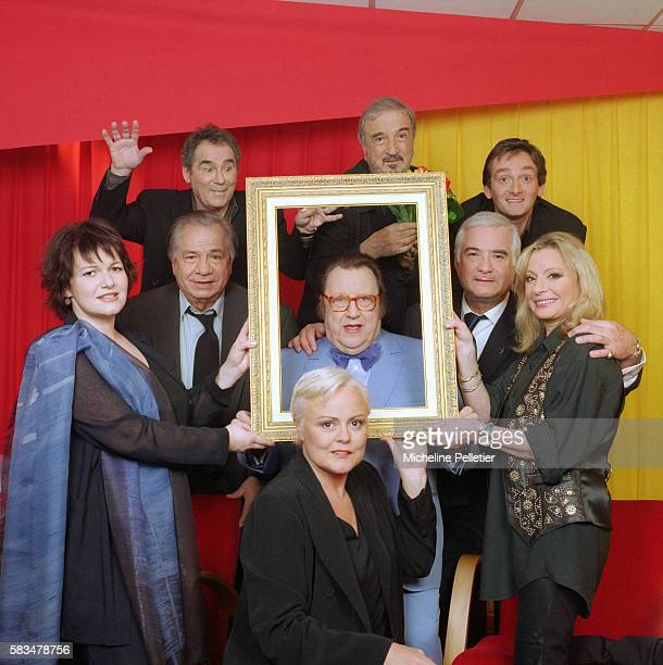 A group of French celebrities gather for a television show honoring Belgian comedian Raymond Devos Clockwise from bottom are actress Muriel Robin...