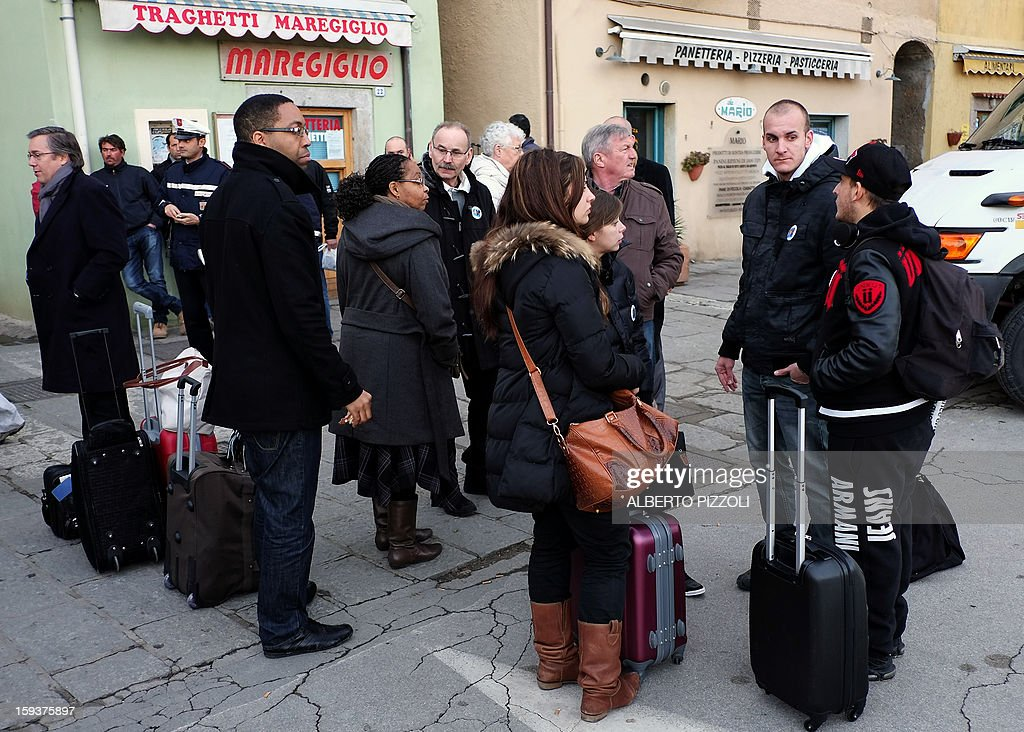 A group of French survivors of the Costa Concordia cruise ship arrive on the Italian island of Giglio on January 12, 2013. Shaken survivors and grieving relatives of the 32 victims of the Costa Concordia cruise ship disaster began arriving on the island of Giglio for a first anniversary commemoration of the tragedy on January 13.