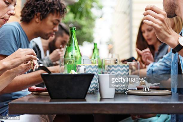 Group of friend eating outdoors