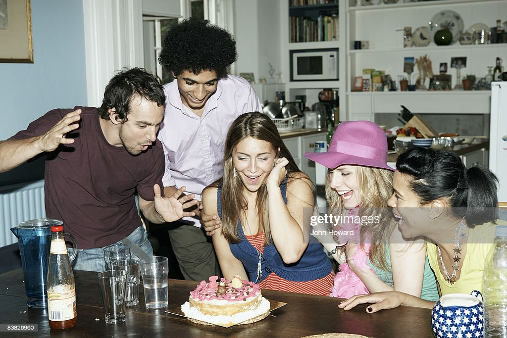 Group of friends admiring cake : Stock Photo