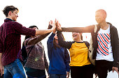 Group of friends all high five together support and teamwork concept