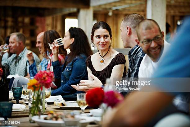 Group of friends and family dining at table