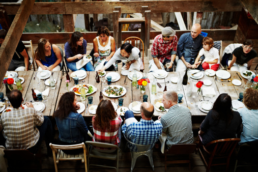 Group of friends and family dining overhead view