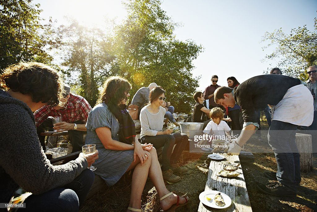 Group of friends and family eating oysters outside