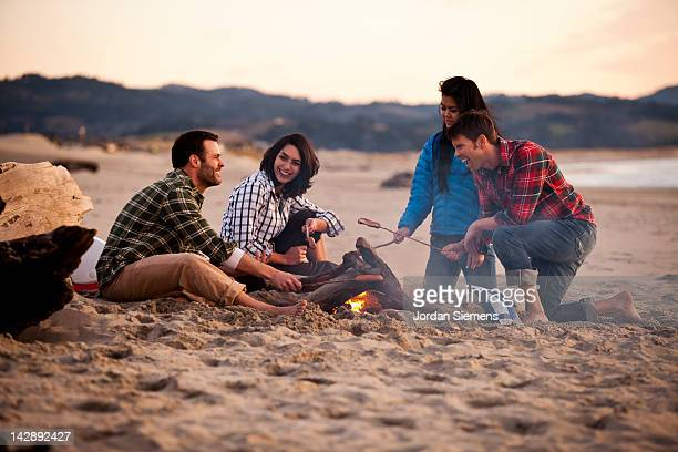 Group of friends around a camp fire.