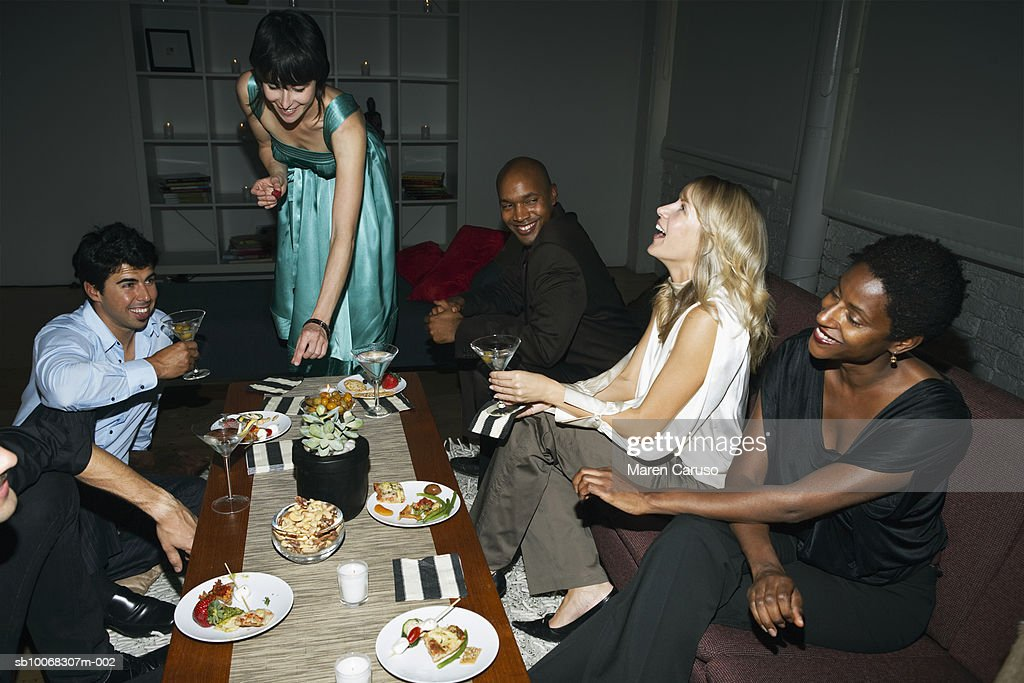 Group of friends around table at cocktail party : Stock Photo