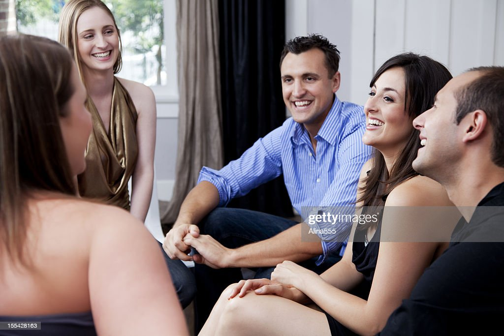 Group of friends at a house party : Stock Photo