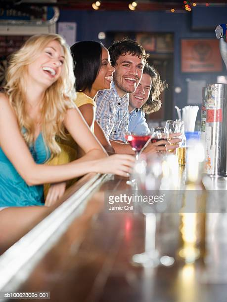 Group of friends at bar, laughing