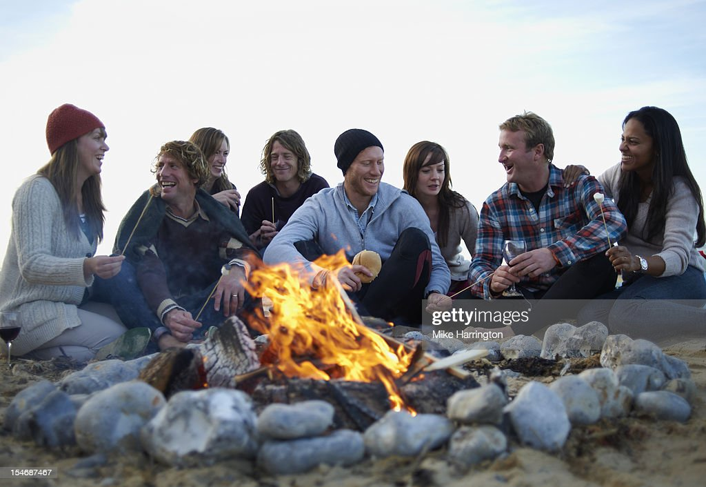 Group of friends at beach party. : Stock Photo