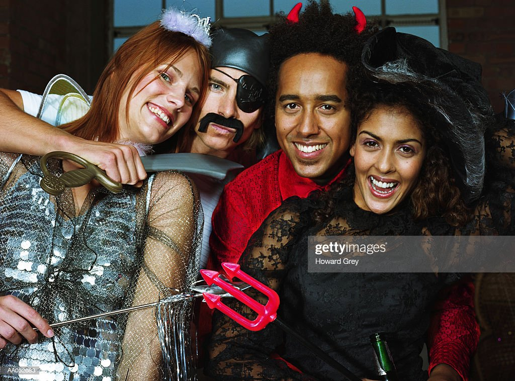 Group of friends at costume party, high section, portrait : Stock Photo