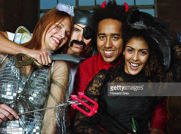 Group of friends at costume party, high section, portrait