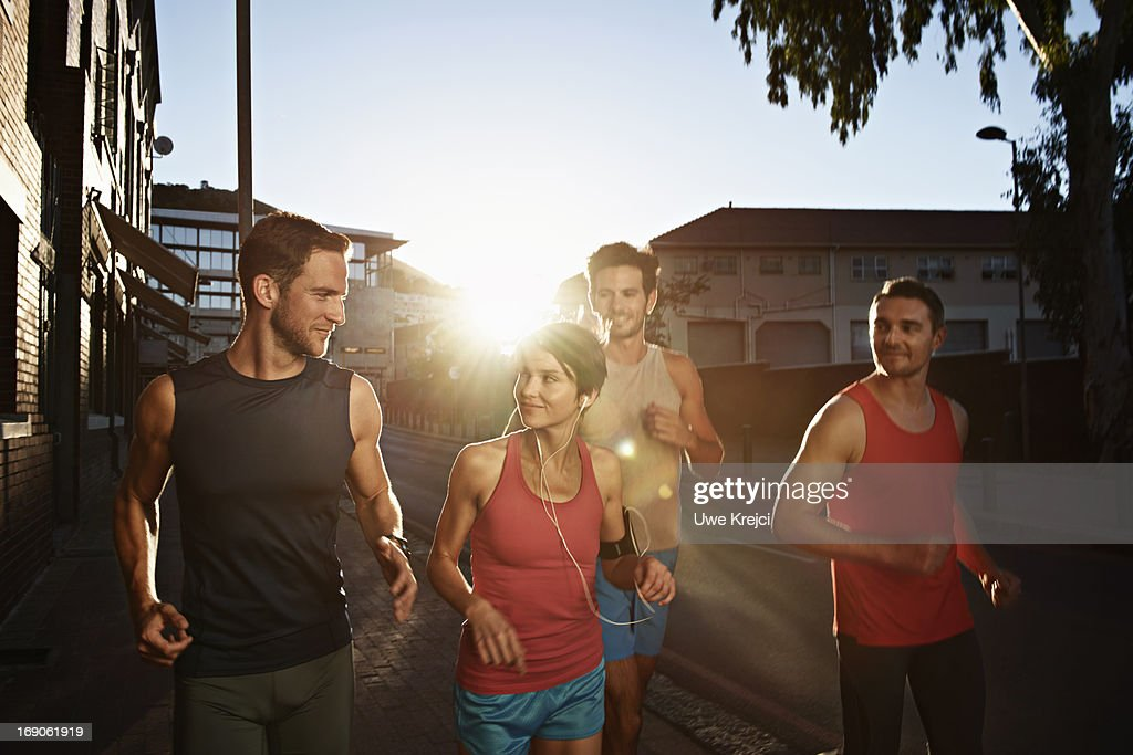 Group of friends at evening run : Stock Photo