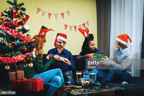 Group of friends at home, celebrating Christmas