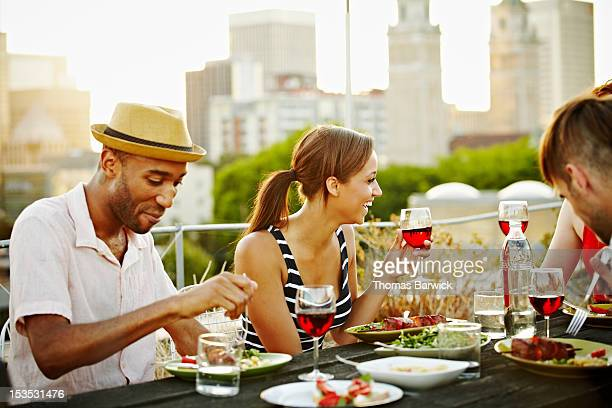 Group of friends at table on rooftop deck