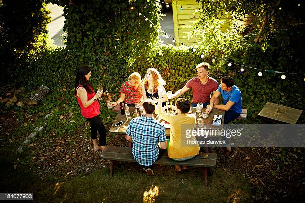 Group of friends at table sharing wine