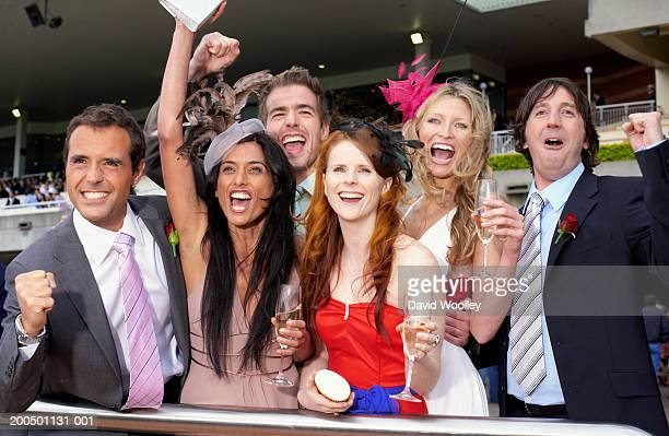 Group of friends at the races, cheering