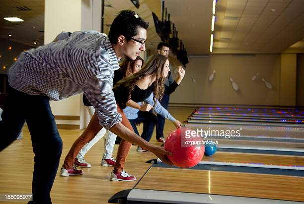A group of friends bowling together