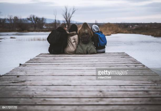 Group of friends by the frozen lake
