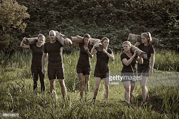 group of friends carrying wooden weights