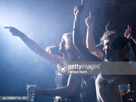Group of friends celebrating at party in night club : Stock Photo