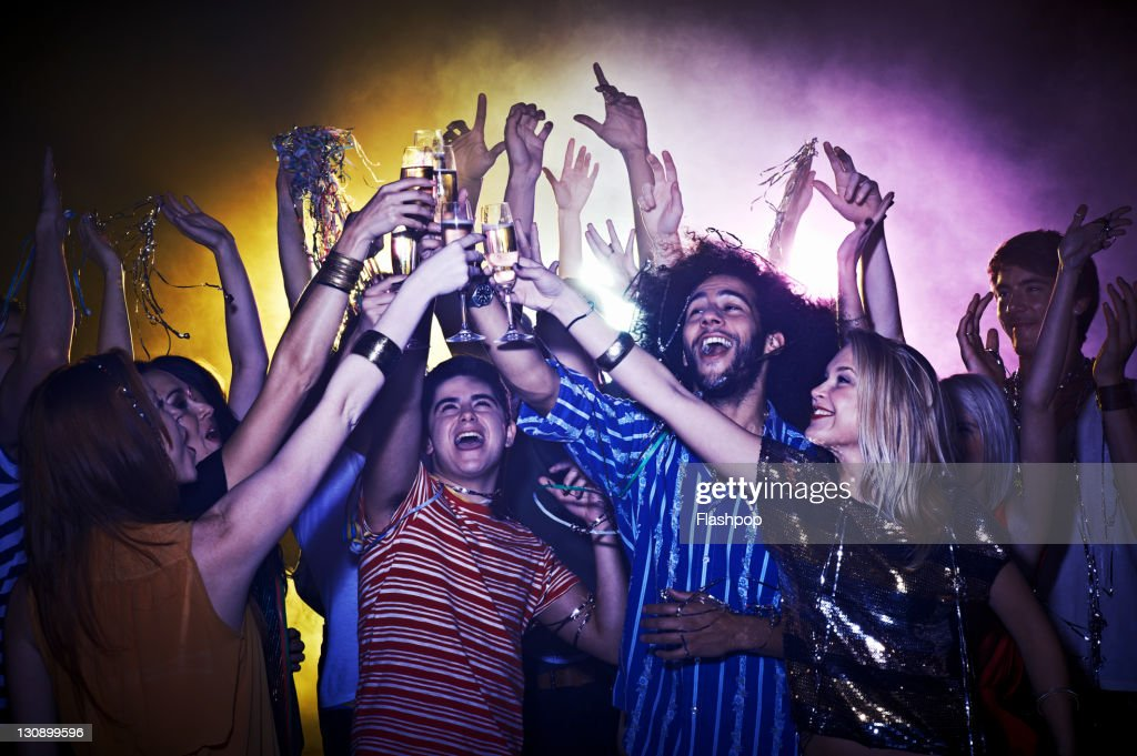 Group of friends celebrating : Stock Photo