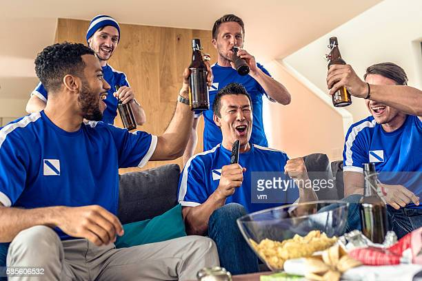Group of friends celebrating sport's victory