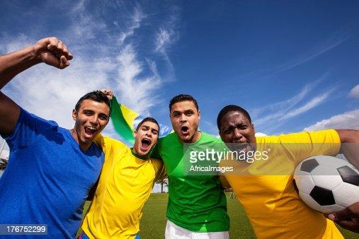 Group of friends cheering for Brazil's soccer team