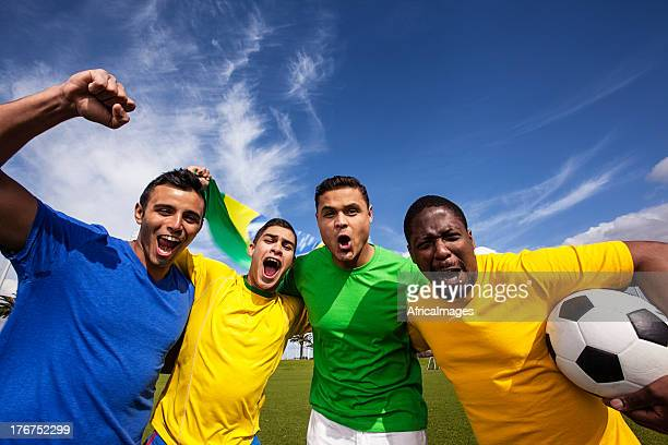 Group of friends cheering for Brazil's soccer team