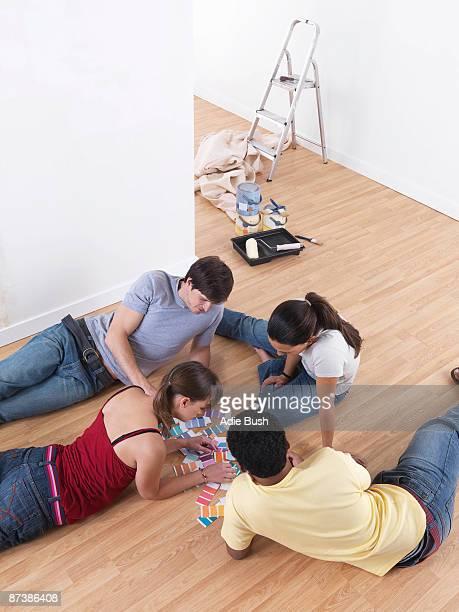 Group of friends choosing paint colours