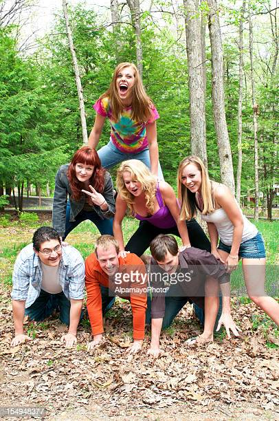 Group of Friends Creates a Human Pyramid