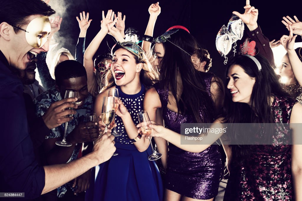 Group of friends dancing and having fun together : Stock Photo