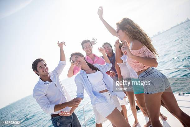 Group of friends dancing in a yacht