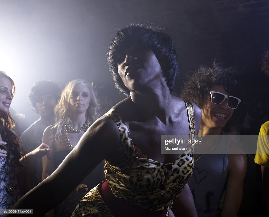 Group of friends dancing in night club : Stock Photo