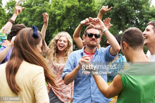group of friends dancing in the park : Stock Photo