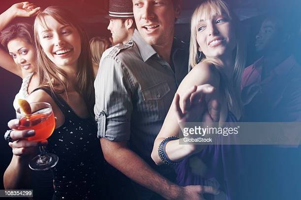 Group of friends dancing while enjoying at party
