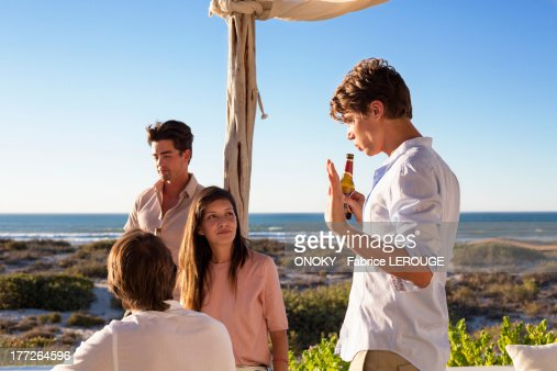 Group of friends discussing : Stock Photo