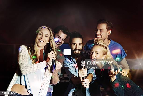 Group of friends doing karaoke