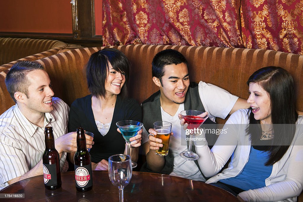 Group of friends drinking and conversing : Stock Photo